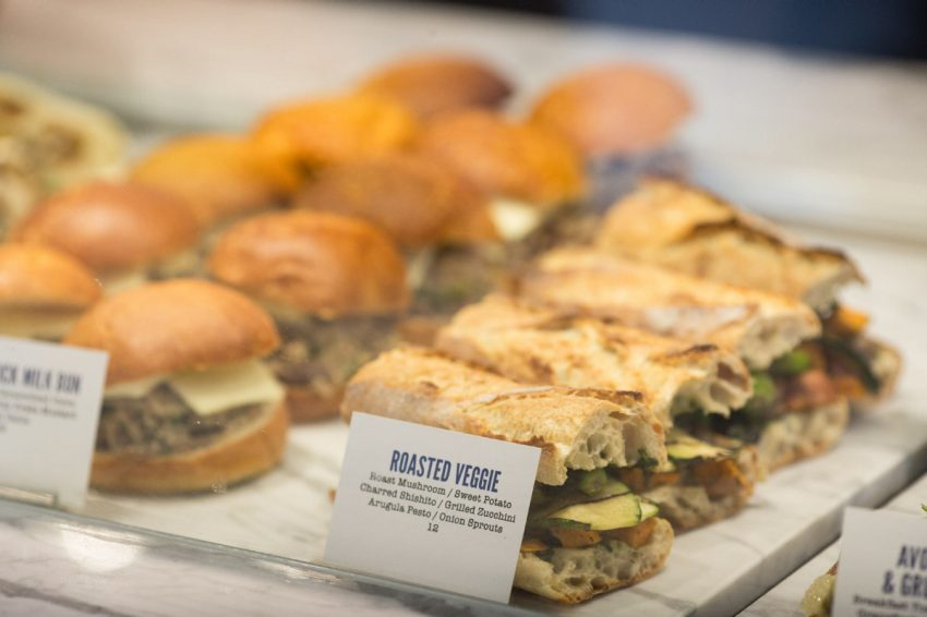 Customers can walk in and nab a pastry, sandwich, slice of pizza or a full hot meal from the counter and take it home or sit down in a front lounge area. (NICK KOZAK)
