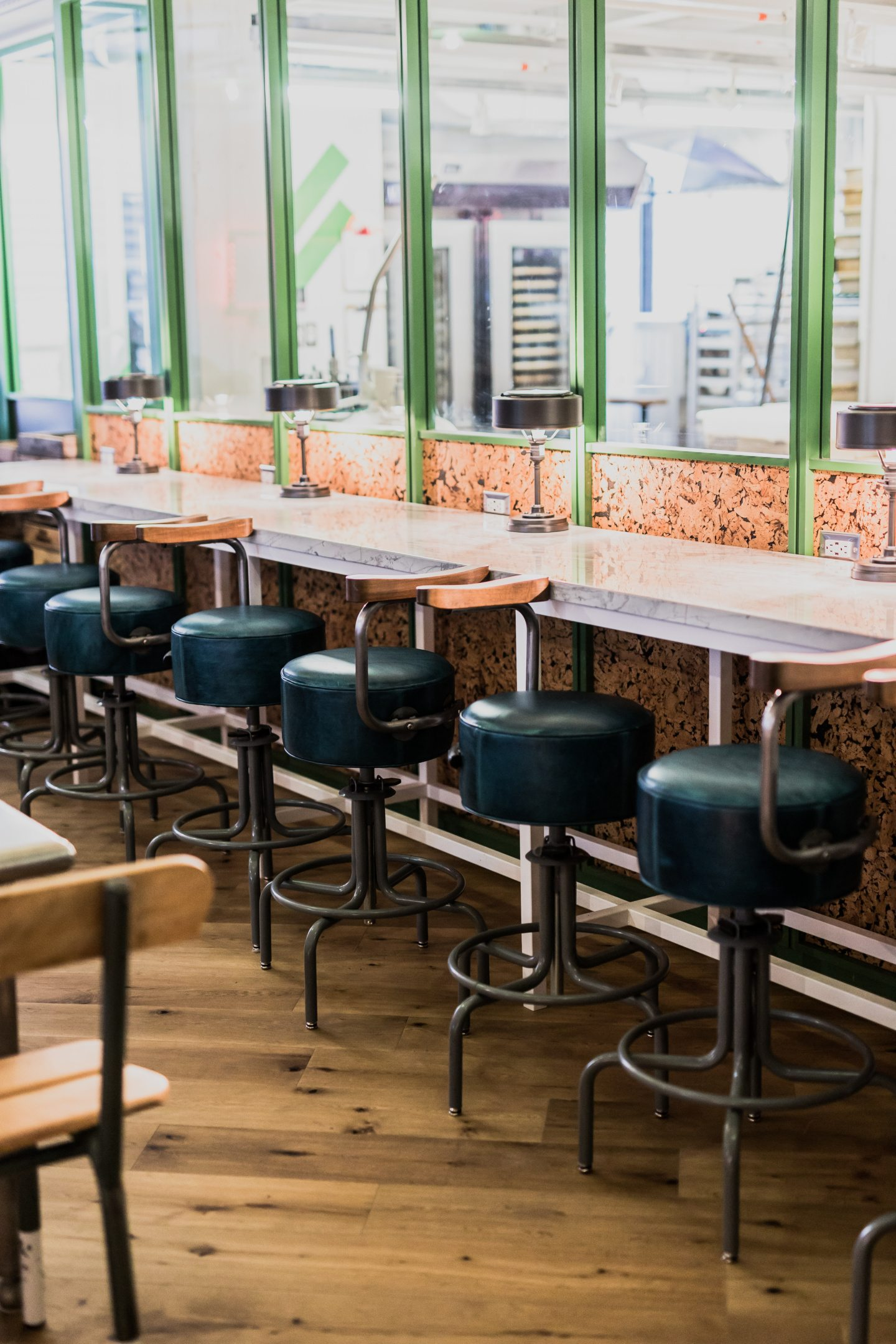 These seats have a view of all the kitchen activity. Photo by Kayla Rocca