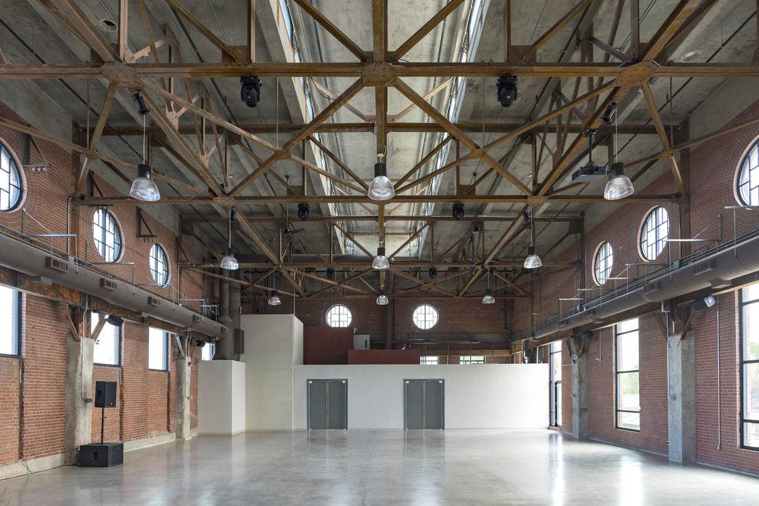 The Symes spent 'a gazillion dollars' restoring the space, highlighting original features such as the concrete columns and steel beams along the ceiling. 5IVE15IFTEEN