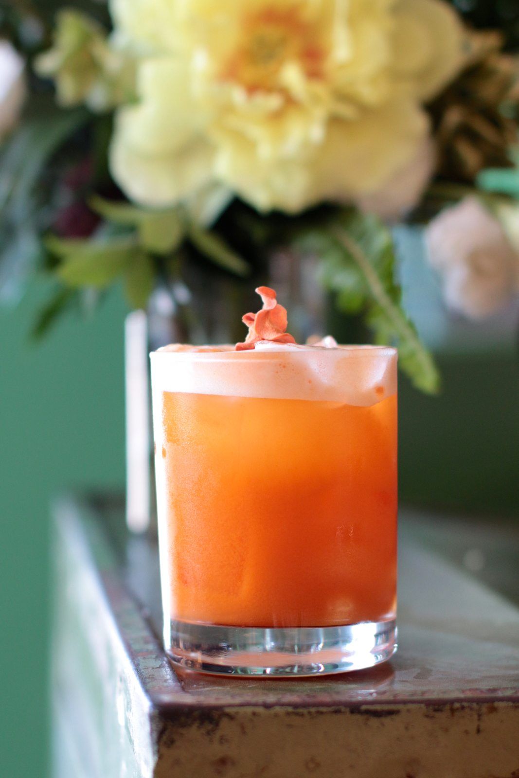 The Queen Street Sour is a mix of Gooderham & Worts Whisky and carrot-apple-tumeric-lemon juice, topped with a chickpea-derived vegan foam. $15.
